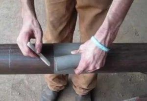 hand marking a tube